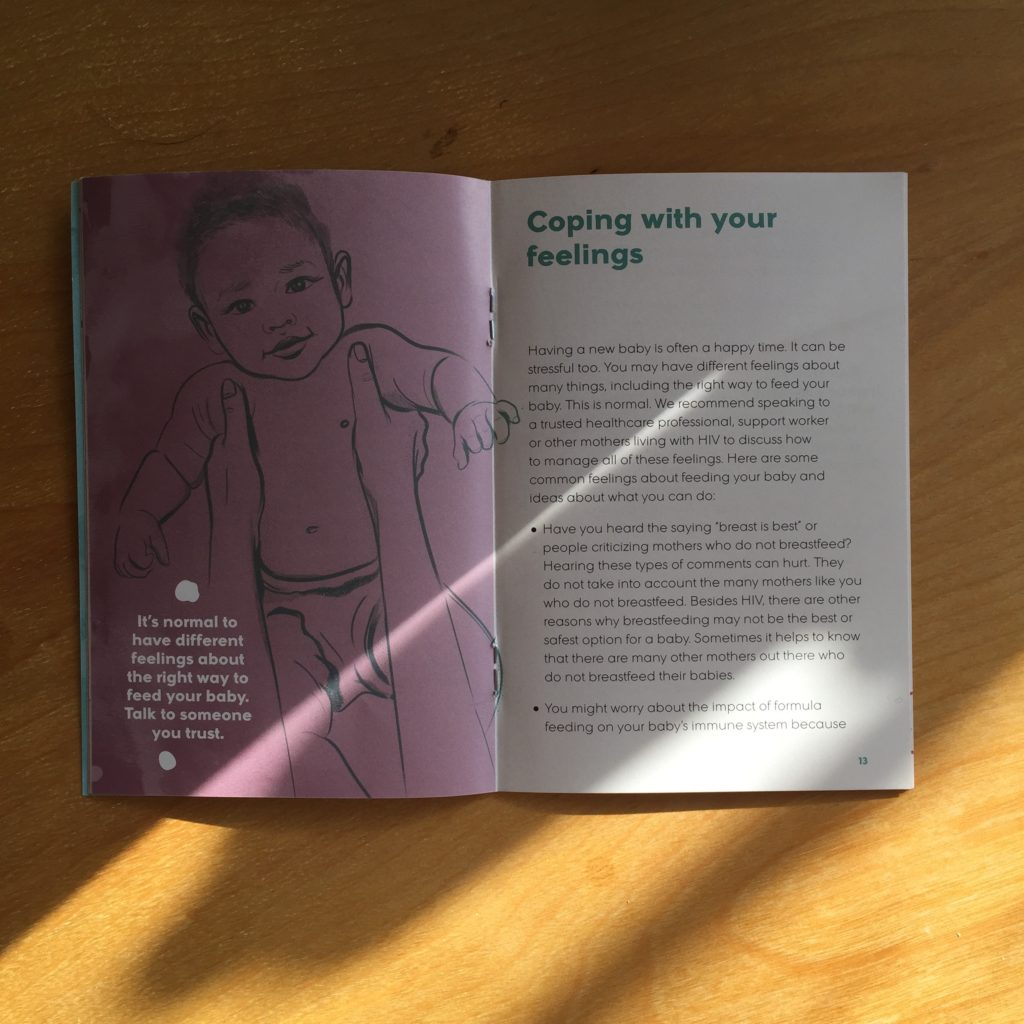 """Photo: Two-page spread from """"Is Formula Good for my Baby?"""" — an infant feeding resource for HIV positive mothers. The right side of the spread is filled with text. The left side is an illustration of a baby being held up by an adult. Only the arms of the adult are visible. On the illustration is large text reading """"It's normal to have different feelings about the right way to feed your baby. Talk to someone you trust."""""""