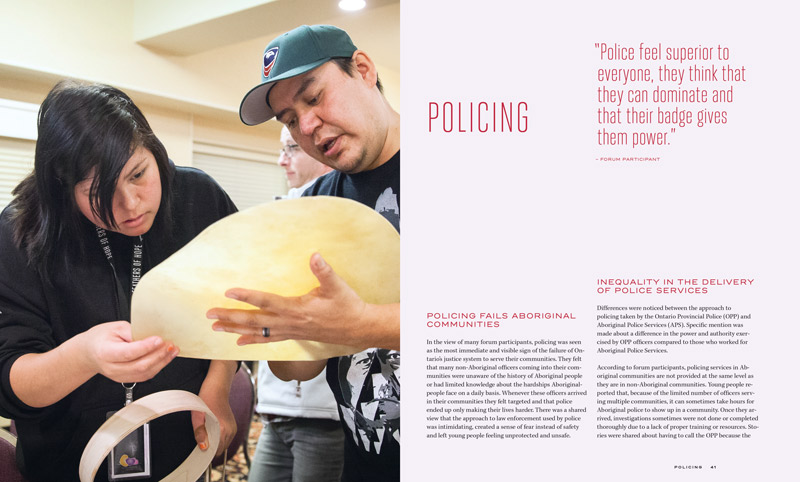 Graphic: A two-page spread from The Feathers of Hope Justice & Juries report. On the left side is an photo of two people. The person on the right is holding a piece of hide for a hand drum while the person on the left looks at the hide and holds a wood hand drum frame. On the right side of the page spread is text on policing and how it fails young Indigenous people.