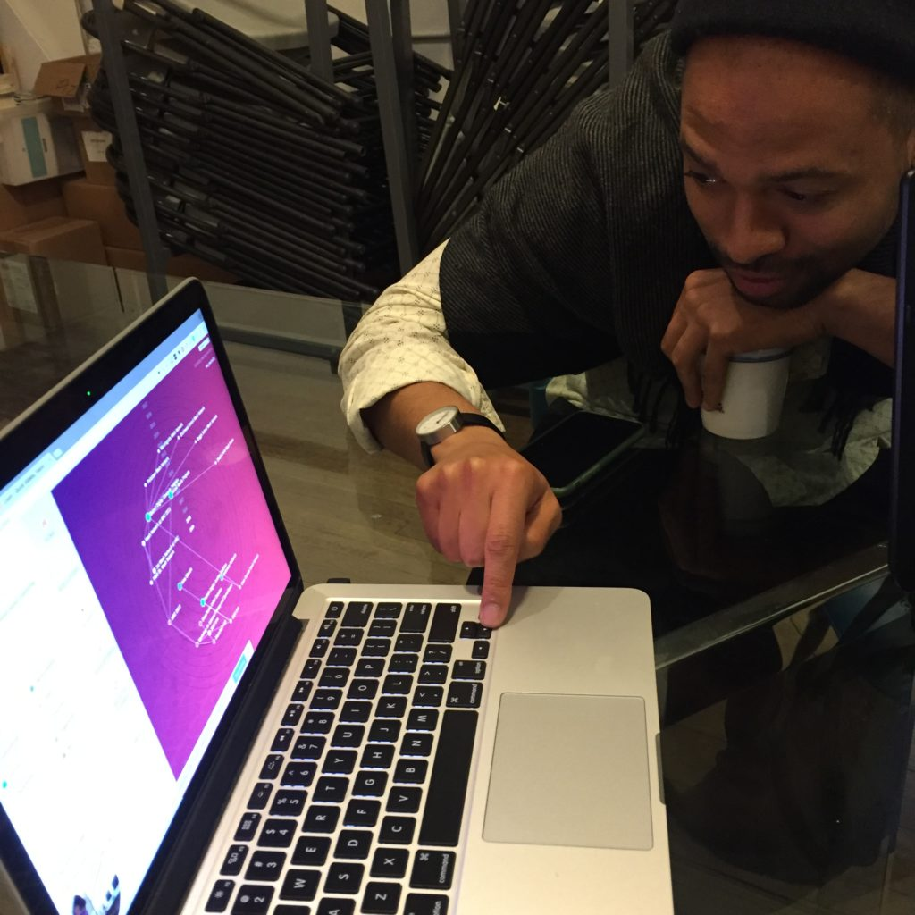 Photo of a young black man pressing a key and interacting with the Ripple Mapping Tool