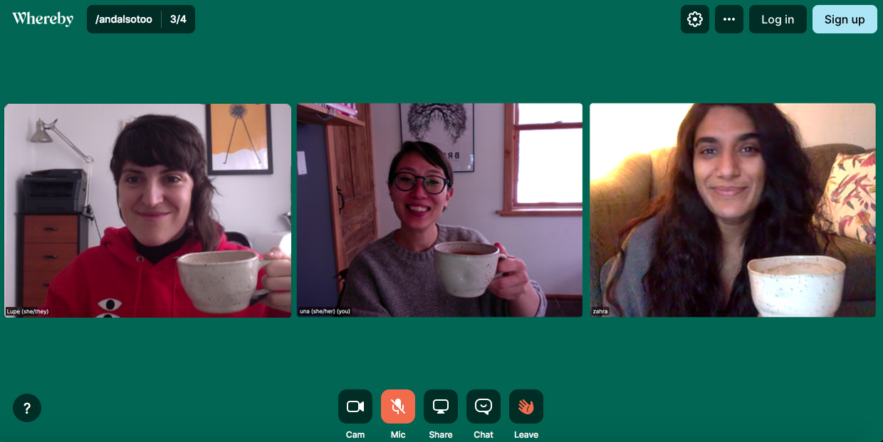 Screenshot of The And Also Too team in a green video conference room. Lupe (left), Una (center) and Zahra (right) smile and hold tea mugs to the camera.